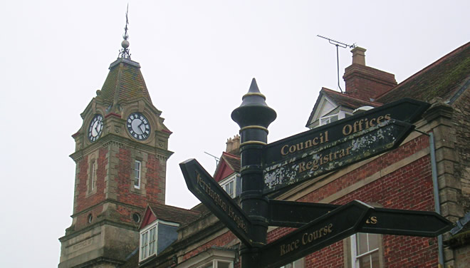 Wincanton Town Hall Clock Tower, with the Market Place sign post in the foreground